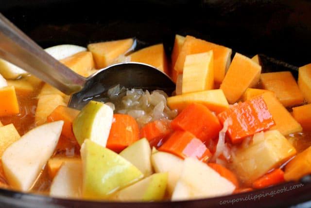 Stir soup ingredients in pot