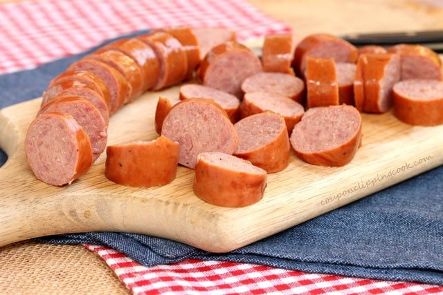 Sliced Smoked Sausage on cutting board