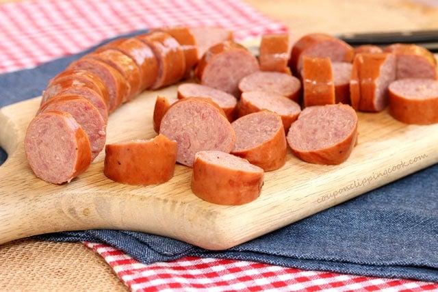 Sliced Smoked Sausage on cutting board