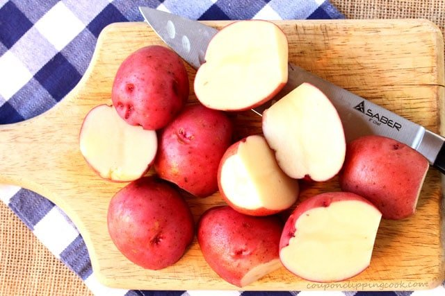 Cut red potatoes on cutting board