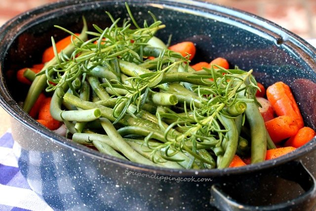 Rosemary on green beans in pan