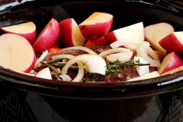 Pot roast and potatoes in pot