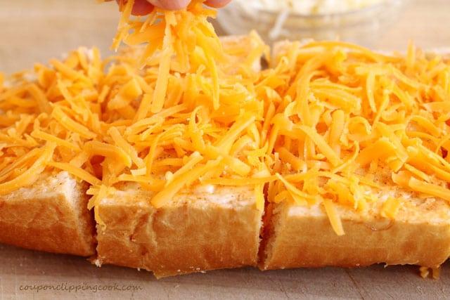 Add shredded cheese on bread