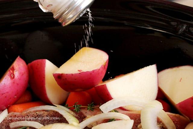 Add salt to potatoes in pot