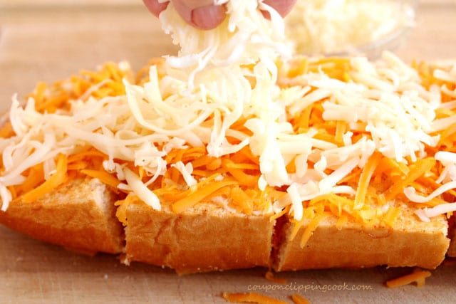 Add shredded cheese on bread