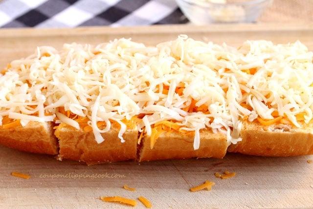 Shredded cheese on garlic bread