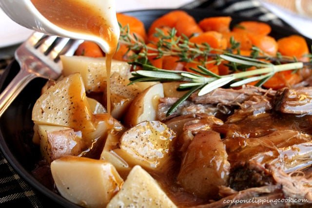 Pour Gravy on Pot Roast with Potatoes