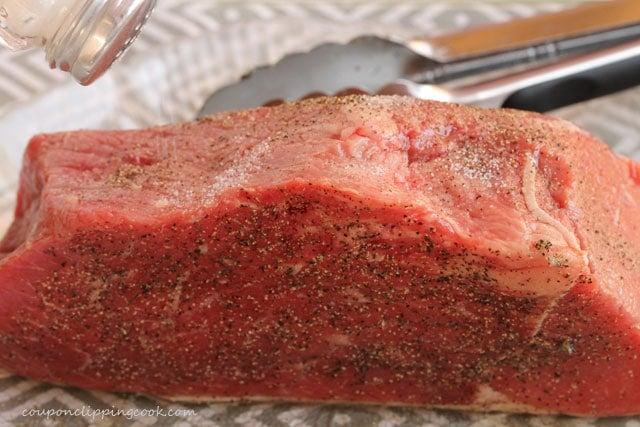 Add salt to beef roast
