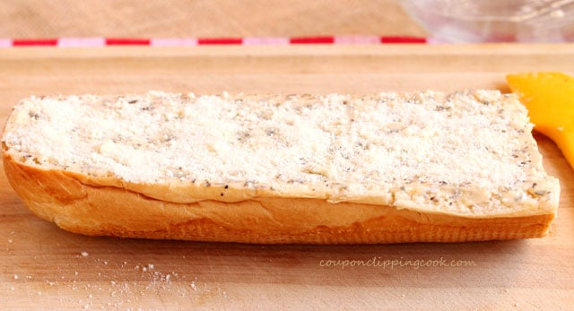 Seasoned butter and parmesan on bread