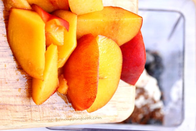 Add cut pieces of peaches in blender
