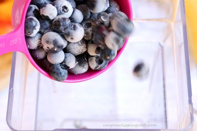 Add blueberries in blender pitcher