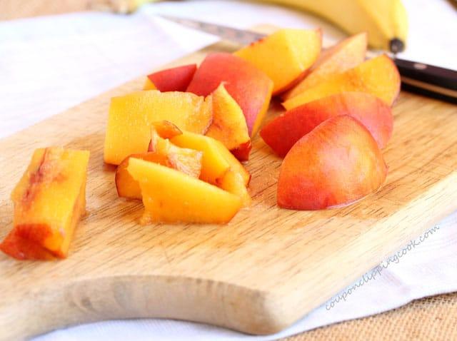 Cut peaches on cutting board