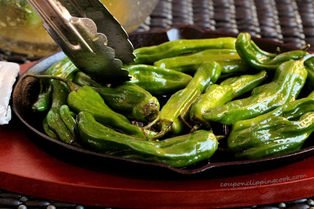 Add shishito peppers on skillet