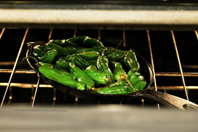 Shishito peppers on skillet in oven