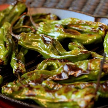 Blistered Shishito peppers on skillet