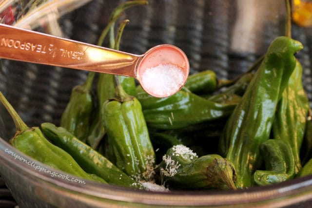 Add salt to shishito peppers