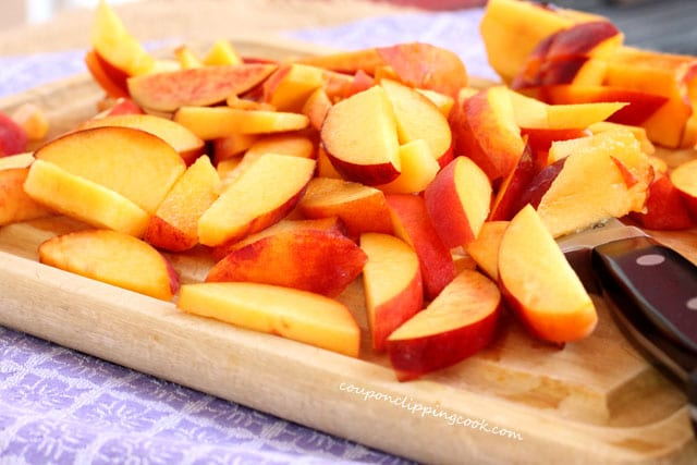 Cut nectarines and peaches on board