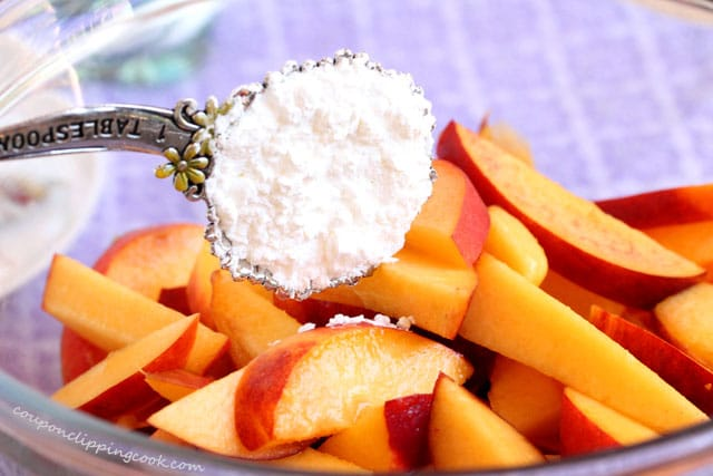 Add corn starch to peaches in bowl