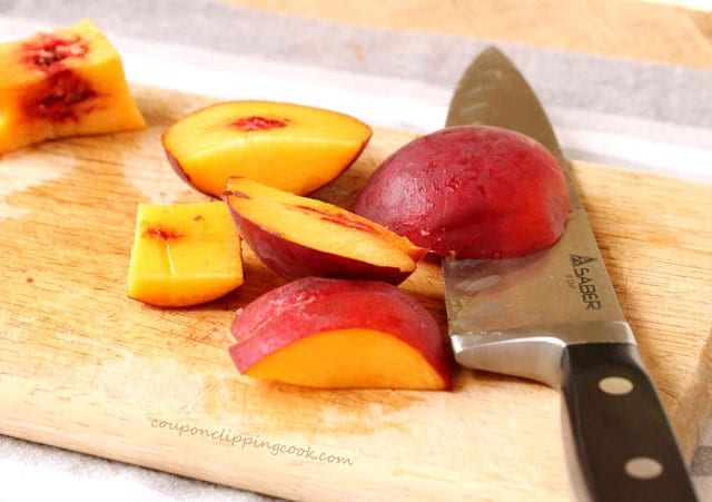 Cut peaches on board