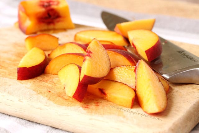 Sliced peaches on cutting board