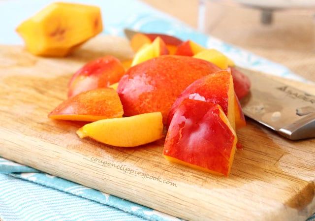 Cut nectarines on board