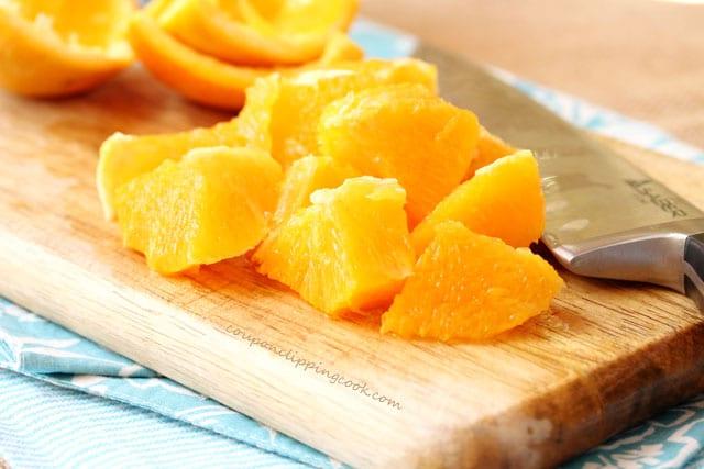 Cut oranges on board