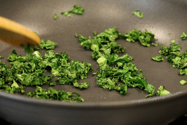 Stir kale in pan
