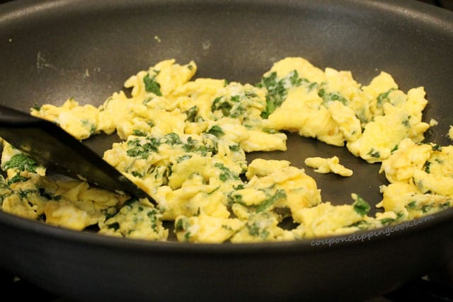 Eggs and kale in pan