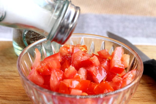 Add salt to chopped tomatoes