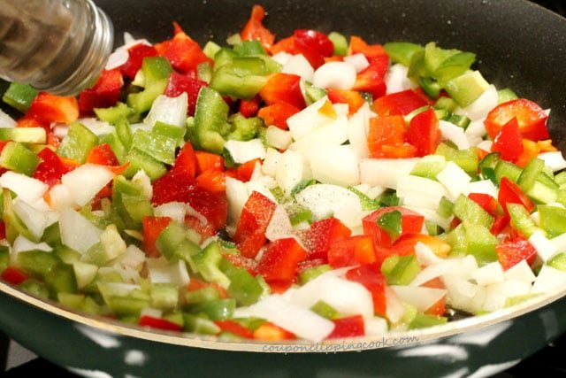 Add pepper on chopped vegetables