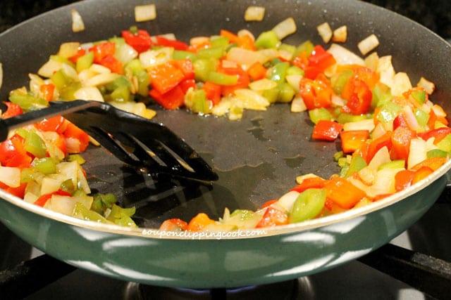 Spread olive oil in skillet