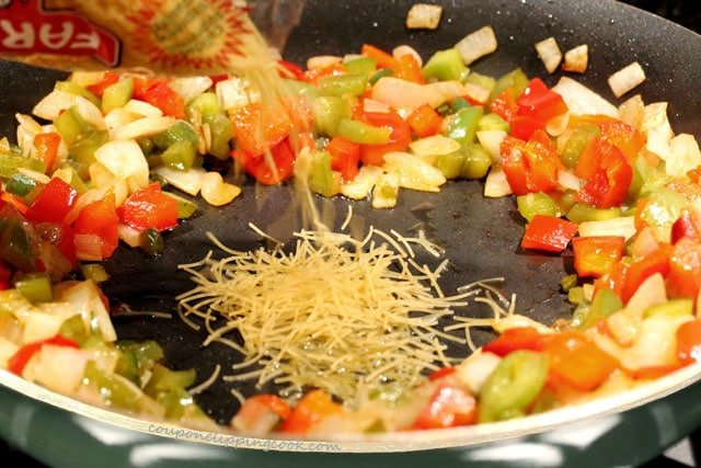 Add fideo pasta in skillet
