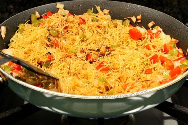 Stir fideo pasta in skillet