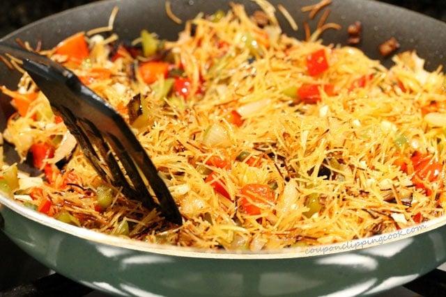 Stir garlic in fideo pasta