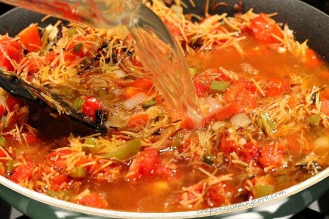 Add chicken broth to pasta