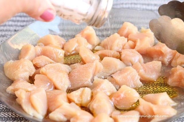 Add salt on cut raw chicken