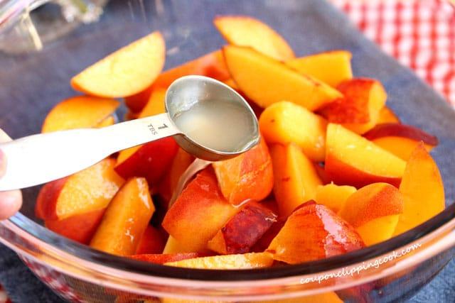 Add lemon juice to sliced peaches