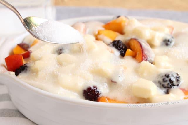 Add sugar on cobbler dessert